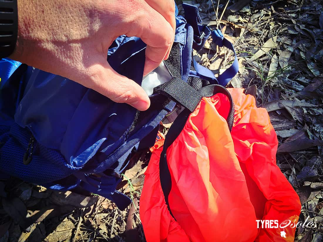 The rain cover is stowed away in a small underside pocket. Pic©Tyres and Soles